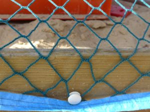 Sandkasten mit Netz am Rundknopf